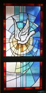 The Holy Spirit stained glass in the narthex