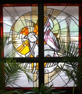 The Lamb of God stained glass in the narthex