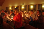 Congregation by candlelight