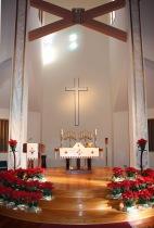The Sanctuary decorated with poinsettias