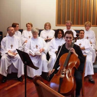 The chancel choir with one of our instrumentalists